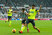 Christopher Schindler (#26) of Huddersfield Town steps in to win the ball from Ayoze Perez (#17) of Newcastle United during the Premier League match between Newcastle United and Huddersfield Town at St. James's Park, Newcastle, England on 23 February 2019.