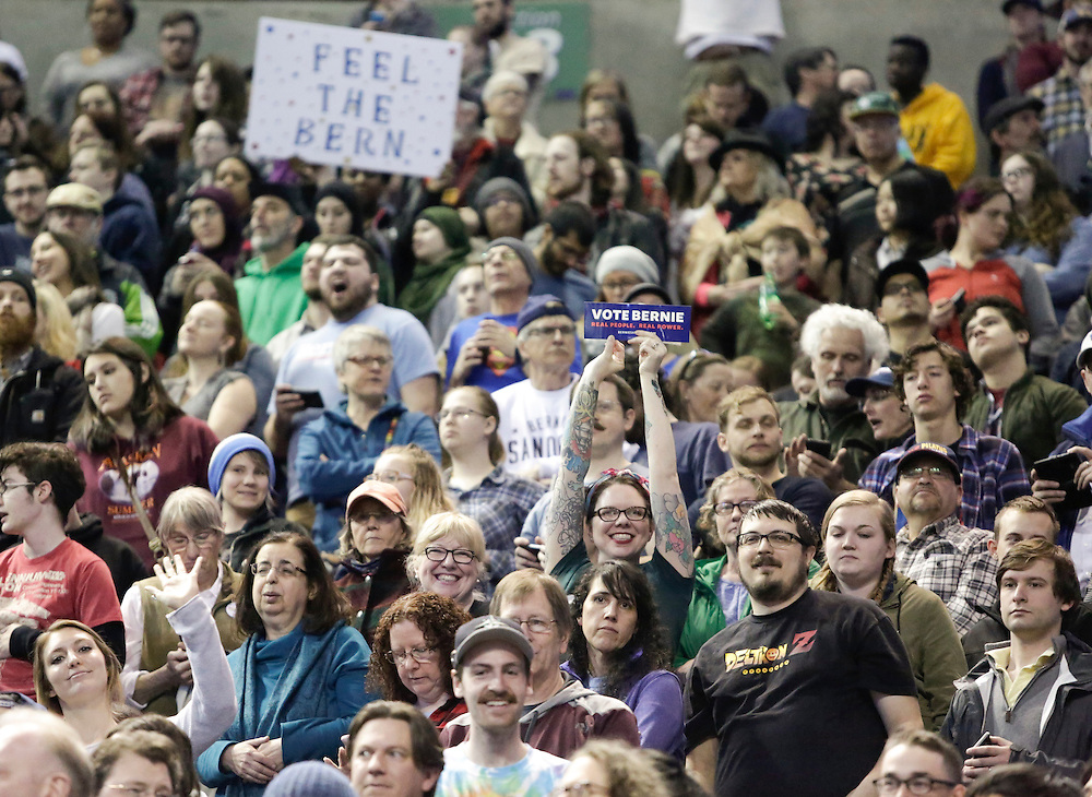 People attend a rally for Democratic presidential candidate Bernie Sanders at Key Arena on March 20, 2016 in Seattle.  AFP PHOTO/JASON REDMOND