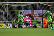 Forest Green Rovers goalkeeper Joe Wollacott(13), on loan from Bristol City saves a shot from Coventry City's Amadou Bakayoko(21) during the Leasing.com EFL Trophy match between Forest Green Rovers and Coventry City at the New Lawn, Forest Green, United Kingdom on 8 October 2019.