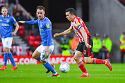 George Honeyman of Sunderland (10) and Tom Naylor of Portsmouth (7) in action during the EFL Sky Bet League 1 first leg Play Off match between Sunderland and Portsmouth at the Stadium Of Light, Sunderland, England on 11 May 2019.