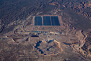 A huge photo-voltaic solar power plant in the desert landscape outside Las Vegas.