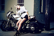 La Donna Segreta - A girl involved in covert operations travels through the city under cover of night on her Ducati.