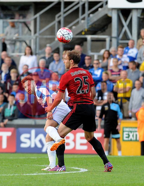 Matty Taylor of Bristol Rovers heads past Craig Dawson of West Brom - Mandatory by-line: Neil Brookman/JMP - 07966386802 - 31/07/2015 - SPORT - FOOTBALL - Bristol,England - Memorial Stadium - Bristol Rovers v West Brom - Pre-Season Friendly