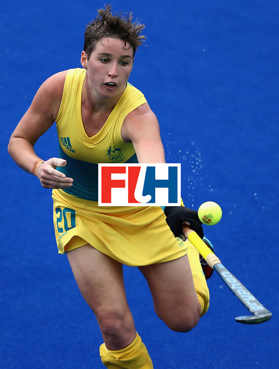 RIO DE JANEIRO, BRAZIL - AUGUST 08:  Kathryn Slattery #20 of Australia lunges for a ball against the United States during a Women's Pool B game on Day 3 of the Rio 2016 Olympic Games at the Olympic Hockey Centre on August 8, 2016 in Rio de Janeiro, Brazil.  (Photo by Sean Haffey/Getty Images)