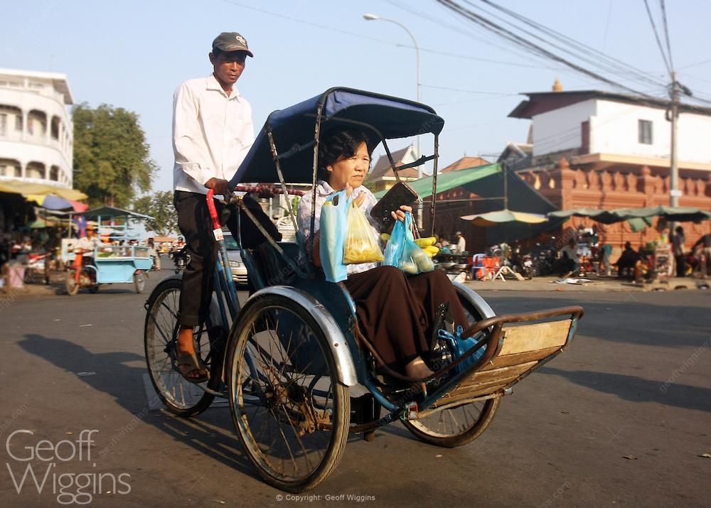 Tricycle rickshaw with passenger, Phnom Penh, Cambodia