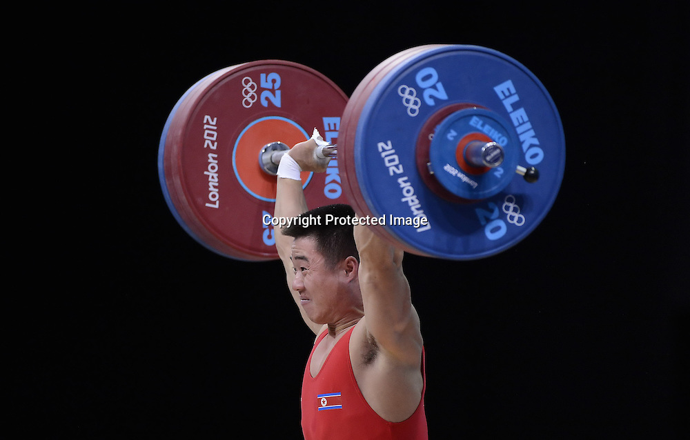Jul 30, 2012; London, ENGLAND; North Korea's Un Guk Kim celebrates his Olympic record lifts in the Men's 62kg Weightlifting at the ExCeL centre, during the third day of the London 2012 Olympics.