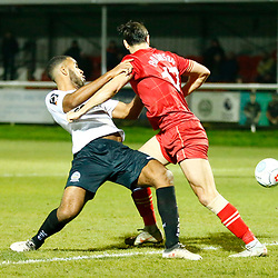 Dover's defender Kevin Lokko is sent crashing to th efloor by Hartlepool's defender Myles Anderson during the National League match between Dover Athletic FC and Hartlepool United FC at Crabble Stadium, Kent on 24 November 2018. Photo by Matt Bristow.