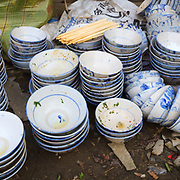 The dishes after the party from a wedding in the Yuang Yang province of China.