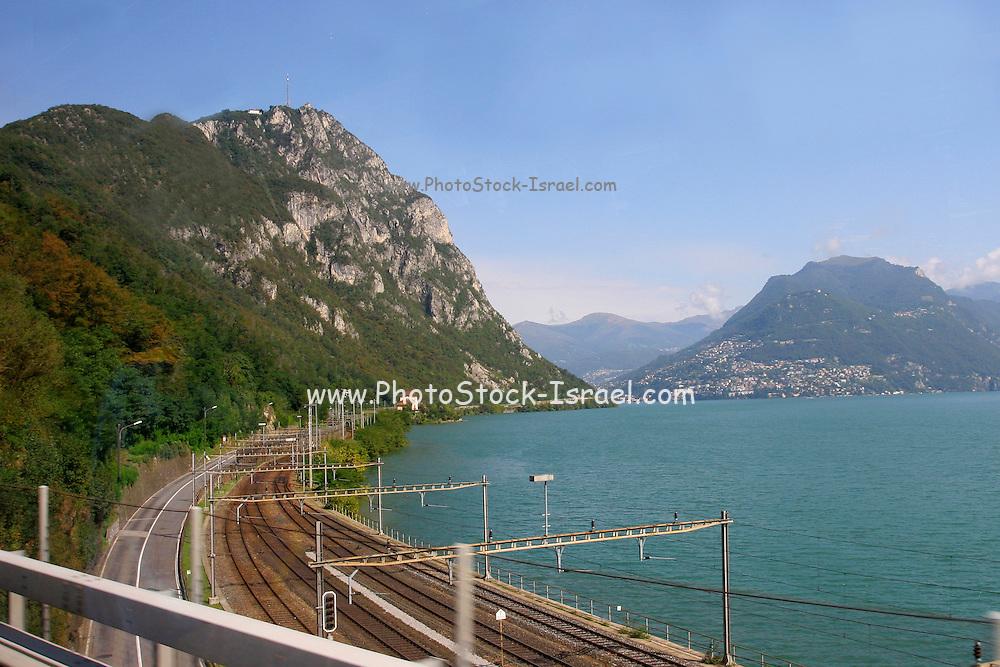Switzerland, Lugano, Railroad track encircles lake Lugano.