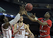Southern California Trojans guard Jonah Mathews (2) and forward Nick Rakocevic (31) battle for the ball with Western Kentucky Hilltoppers guard Lamonte Bearden (1) in the first half during an NCAA college basketball game in the second round of the NIT tournament in Los Angeles, Monday, Mar 19, 2018. WKU defeated USC 79-75.