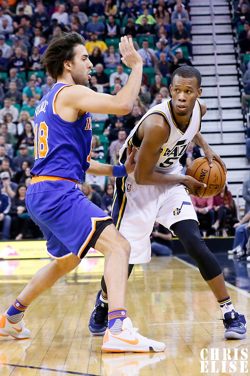 09 December 2015: Utah Jazz guard Rodney Hood (5) looks to pass the ball past New York Knicks guard Sasha Vujacic (18) during the Utah Jazz 106-85 victory over the New York Knicks, at the Vivint Smart Home Arena, Salt Lake City, Utah, USA.