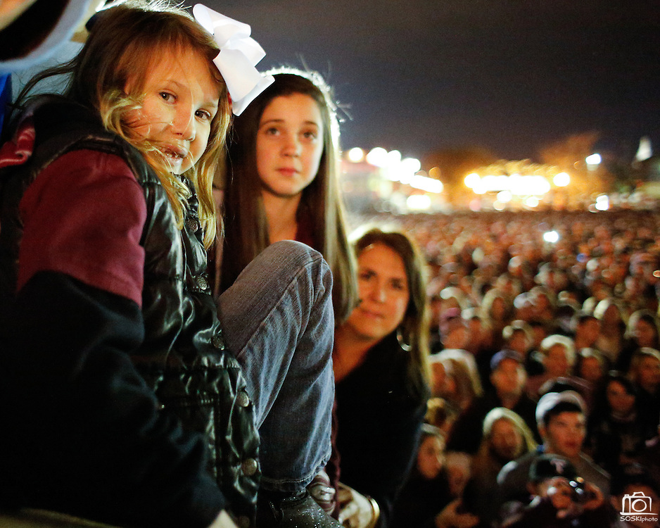 Montgomery Popham, 6, joins her family and thousands of other Texas A&M Aggie fans at Stockyards Station for the pre-Cotton Bowl midnight Aggie Yell practice in Fort Worth, Texas, on January 4, 2012.  (Stan Olszewski/The Dallas Morning News)
