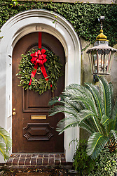 December 21, 2017 - Charleston, South Carolina, United States of America - A wooden door on a historic home decorated with a Christmas wreath on Legare Street in Charleston, SC. (Credit Image: © Richard Ellis via ZUMA Wire)