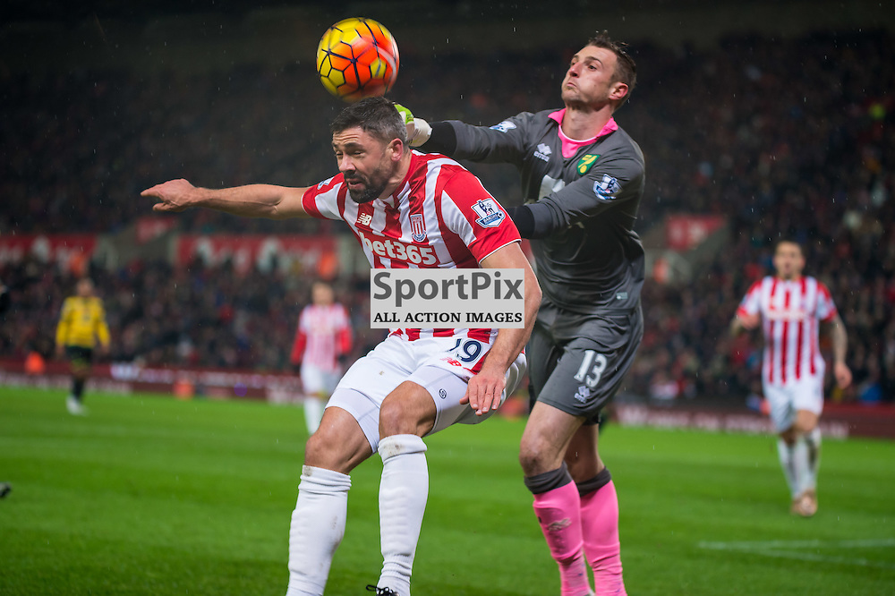 Stoke City forward Jonathan Walters (19) and Norwich City goalkeeper Declan Rudd (13) challenge for a high ball