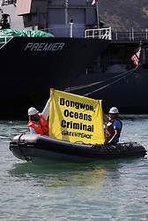 MAURITIUS PORT LOUIS 21APR13 - Greenpeace activists protest in Port Louis, Mauritius against the South Korean vessel Premier accused of illegal fishing in African waters.<br /> <br /> The Greenpeace ship Esperanza is on patrol documenting fishing activities in the Indian Ocean.<br /> <br /> jre/Photo by Jiri Rezac / Greenpeace