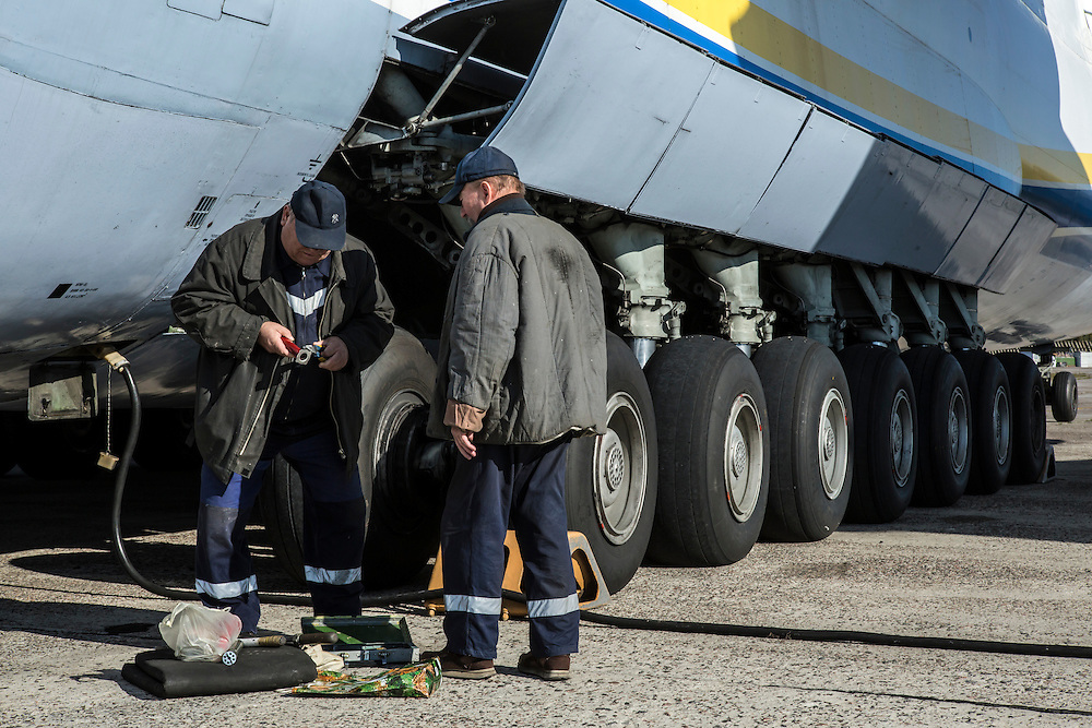 GOSTOMEL, UKRAINE - OCTOBER 1, 2014: Workers perform maintenance on the Antonov AN-225, the longest and heaviest airplane ever built, on an airfield in Gostomel, outside Kiev, Ukraine. CREDIT: Brendan Hoffman for The New York Times