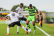 Forest Green Rovers Keanu Marsh-Brown (7) is tackled by Bromley's Reece Prestedge(16) during the Vanarama National League match between Forest Green Rovers and Bromley FC at the New Lawn, Forest Green, United Kingdom on 17 September 2016. Photo by Shane Healey.