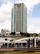 A Chao Phraya River Express boat stops opposite The Peninsula Hotel.