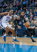 OKLAHOMA CITY, OK - FEBRUARY 26: Orlando Magic Guard D.J. Augustin (14) driving to the basket while Oklahoma City Thunder Forward Josh Huestis (34) plays defense at Chesapeake Energy Arena Oklahoma City, OK (Photo by Torrey Purvey/Icon Sportswire)