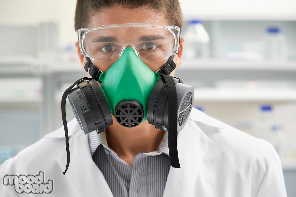 Scientist wearing gas mask in laboratory
