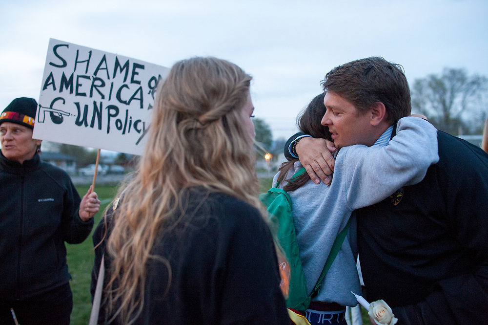 Jay Bostrom being hugged by others at the candlelight vigil on May 2, 2014 at the Fort Missoula soccer field for Diren Dede, a German exchange student who was killed. Jay Bostrom was Dede's Spanish teacher and soccer coach.