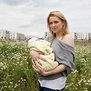 Warsaw, Poland, June 27, 2013. Katarzyna, 32 years old, with her newborn babygirl Dominika.