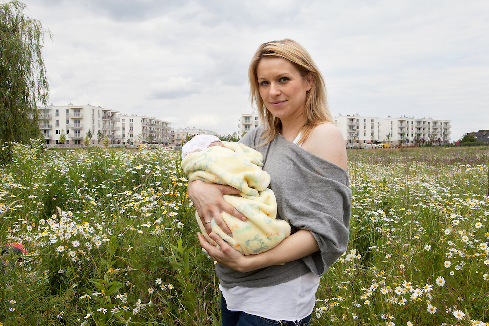 Warsaw, Poland, June 27, 2013. Katarzyna, 32 years old, with her newborn babygirl Dominika.