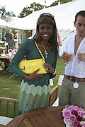 June Sarpong, Cartier International Polo. Guards Polo Club. Windsor Great Park. 30 July 2006. ONE TIME USE ONLY - DO NOT ARCHIVE  © Copyright Photograph by Dafydd Jones 66 Stockwell Park Rd. London SW9 0DA Tel 020 7733 0108 www.dafjones.com