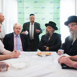 London, UK - 7 August 2014: The Mayor Boris Johnson visits Rabbi Oscher Schapiro and the Orthodox Jewish community in Stamford Hill, London