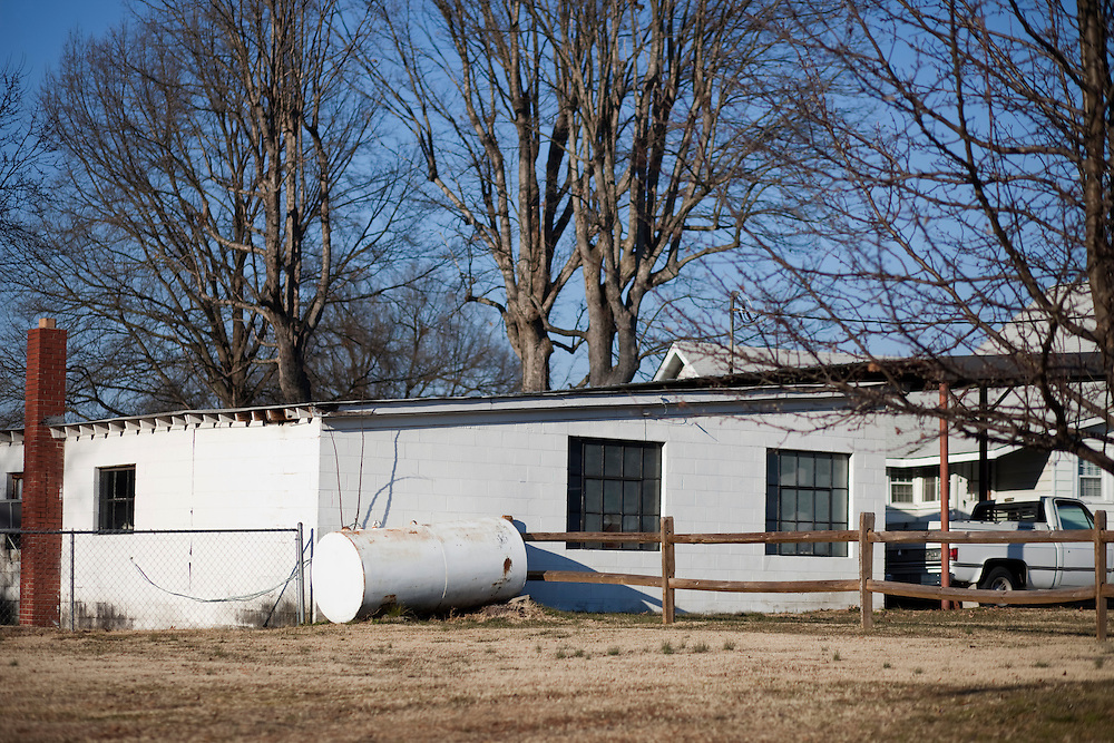"""The garage and shop of Dale Earnhardt's childhood home in Kannapolis, N.C., where his father, Ralph, worked on his own race cars. """"When I was a kid,"""" Dale once said, """"I would do anything I could to help, to be around racing."""" On school nights when he couldn't tag along to watch his dad race, Dale would race to the garage the next morning. He said he could tell just by looking at the car how well his dad had done the night before. """"If there were a lot of tire marks on the doors, he'd probably won 'cause guys had beat and banged on him trying to get around."""""""