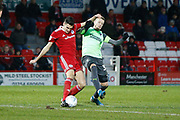 Joe Pigott of Wimbledon tackles Ross Sykes of Accrington   during the EFL Sky Bet League 1 match between Accrington Stanley and AFC Wimbledon at the Fraser Eagle Stadium, Accrington, England on 1 February 2020.
