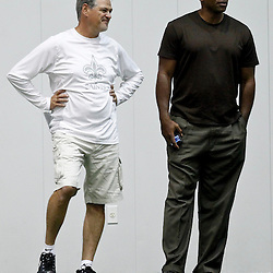 July 27, 2012; Metairie, LA, USA; New Orleans Saints general manager talks with New Orleans Hornets general manager Dell Demps on the sideline during training camp practice at the team's indoor practice facility. Mandatory Credit: Derick E. Hingle-US PRESSWIRE
