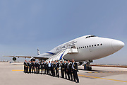 El Al flight crew stand with Eliezer Shkedi El Al CEO (centre) in front of a Boeing 747 passenger plane