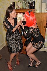 Left to right, AVERYL OATES and KIM JOHNSON at the Bumpkin Halloween Dinner hosted by Marissa Hermer held at Bumpkin, 119 Sydney Street, London on 23rd October 2014.