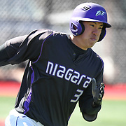 Geoff Seto #3 of the Niagara Purple Eagles runs down the first base line during the game at Friedman Diamond on March 16, 2014 in Brookline, Massachusetts. (Photo by Elan Kawesch)