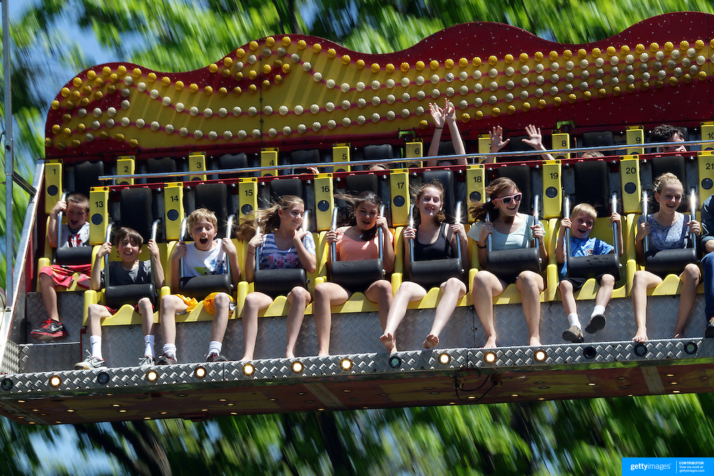Children enjoy the Ali Baba ride during the May Fair at Saint Mark's Church, New Canaan, Connecticut, USA. 12th May 2012. Photo Tim Clayton