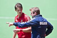 MELBOURNE -  Belgie coach Marc Lammers met Felix Denayer (l)  tijdens de wedstrijd om de vijfde plaats  tussen de mannen van Belgie en Duitsland (5-4 GG) bij de Champions Trophy hockey in Melbourne. ANP KOEN SUYK