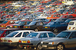 Rows of cars parked in car park,