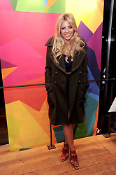 MOLLIE KING at a party to celebrate the Firetrap Watches and Kate Moross Collaboration Launch, held at Firetrap, 21 Earlham Street, London, UK on 13th October 2010.