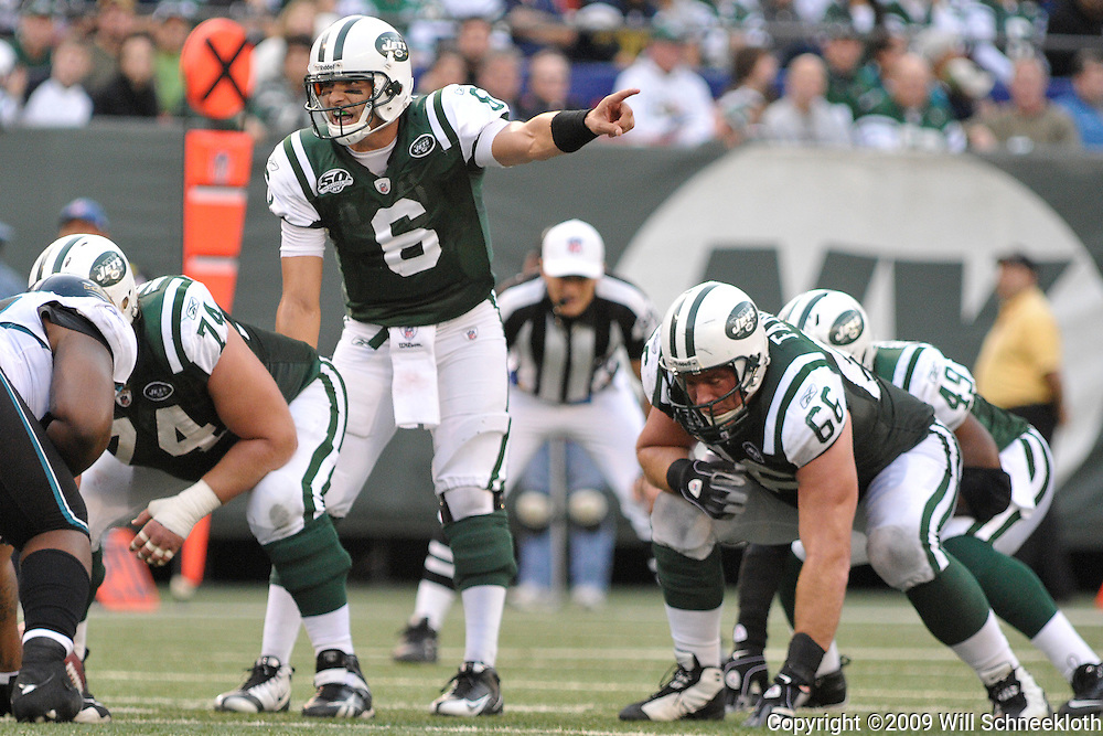 Nov 15, 2009; East Rutherford, NJ, USA; New York Jets quarterback Mark Sanchez (6) gives instructions at the line of scrimmage during second half NFL action in the Jacksonville Jaguars 24-22 victory over the New York Jets at Giants Stadium.