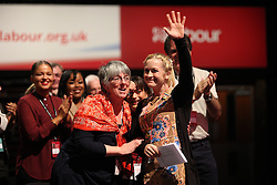 © Licensed to London News Pictures . 30/09/2015 . Brighton , UK . Delegate SUZANNE KERVIN (r) of UCATT is congratulated after delivering an impassioned speech to the conference . The 2015 Labour Party Conference . Photo credit : Joel Goodman/LNP