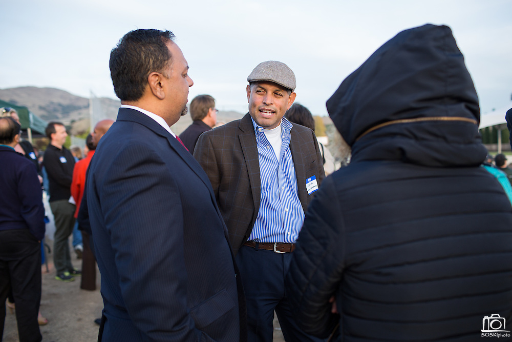 Joe Vela, center, talks with other guests during the Milpitas Unified School District and San Jose Evergreen Community College District Community College Extension Ground Breaking Ceremony near Russell Middle School in Milpitas, California, on November 17, 2015. (Stan Olszewski/SOSKIphoto)