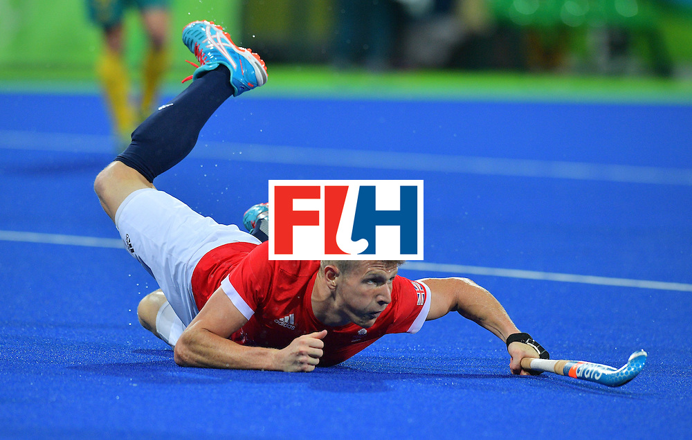 Britain's Sam Ward falls during the men's field hockey Britain vs Australia match of the Rio 2016 Olympics Games at the Olympic Hockey Centre in Rio de Janeiro on August, 10 2016. / AFP / Carl DE SOUZA        (Photo credit should read CARL DE SOUZA/AFP/Getty Images)