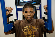 "Felipe Adams, a 30-year-old Iraq war veteran who was paralyzed by a sniper's bullet in Baghdad, Iraq, works on his upper body strength during a rehab session at the VA Long Beach Medical Center in Inglewood, California. (From the book What I Eat: Around the World in 80 Diets.) The caloric value of his day's worth of food on a day in the month of September was 2100 kcals. He is 30; 5'10"" and 135 pounds. MODEL RELEASED."