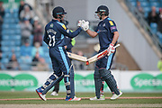 Joe Root (Yorkshire CCC) congratulates Jonny Bairstow (Yorkshire CCC) on reaching his 150 during the Royal London 1 Day Cup match between Yorkshire County Cricket Club and Durham County Cricket Club at Headingley Stadium, Headingley, United Kingdom on 3 May 2017. Photo by Mark P Doherty.