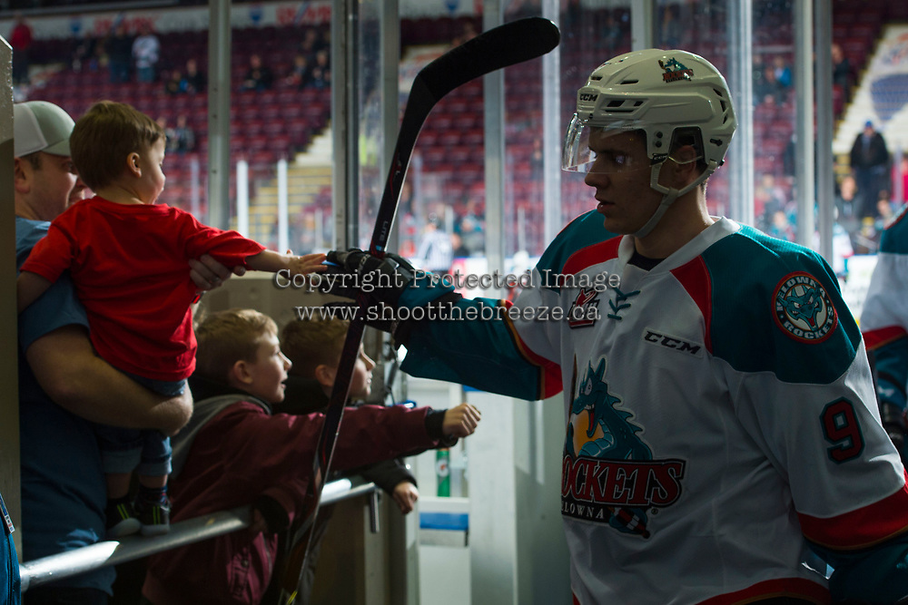 KELOWNA, CANADA - FEBRUARY 24: Marek Skvrne #9 of the Kelowna Rockets high fives a young fan as he exits the ice after warm up against the Kamloops Blazers  on February 24, 2018 at Prospera Place in Kelowna, British Columbia, Canada.  (Photo by Marissa Baecker/Shoot the Breeze)  *** Local Caption ***