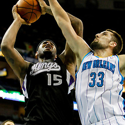 Jan 21, 2013; New Orleans, LA, USA; Sacramento Kings center DeMarcus Cousins (15) shoots over New Orleans Hornets power forward Ryan Anderson (33) during the second half of a game at the New Orleans Arena. The Hornets defeated the Kings 114-105. Mandatory Credit: Derick E. Hingle-USA TODAY Sports