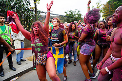 © Licensed to London News Pictures. 30/08/2015. London, UK. Dancers parading at Notting Hill Carnival in west London on family day, Sunday, August 30, 2015. Photo credit: Tolga Akmen/LNP