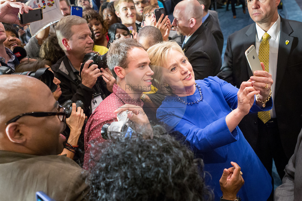 Democratic presidential candidate Hillary Rodham Clinton takes a selfie with a supporter following the Breaking Down Barriers Forum on gun violence at Central Baptist Church February 23, 2016 in Columbia, South Carolina. The event was attended by mothers who lost their children to gun violence and police incidents.
