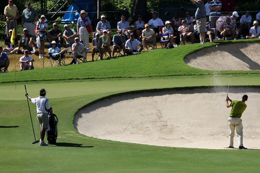 11 August 2007: Tom Lehman blasts out of the green-side bunker on the 4th hole during the third round of the 89th PGA Championship at Southern Hills Country Club in Tulsa, OK.